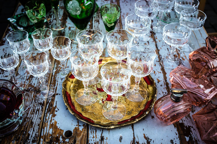 High angle view of glasses and bottles on table at market