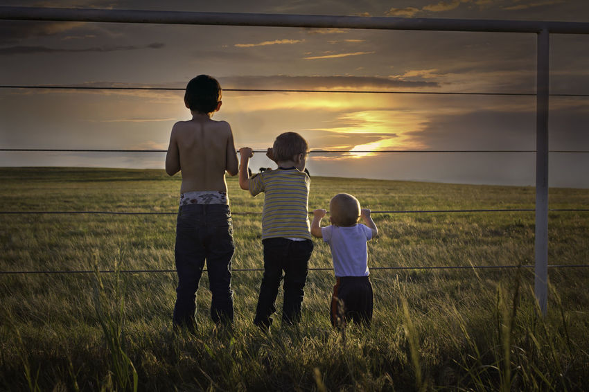 Timeless Moments Beauty In Nature Bonding Boys Child Childhood Cloud - Sky Family With Two Children Father Field Full Length Girls Grass Growth Landscape Lifestyles Love Nature Outdoors Real People Scenics Sky Son Standing Sunset Togetherness