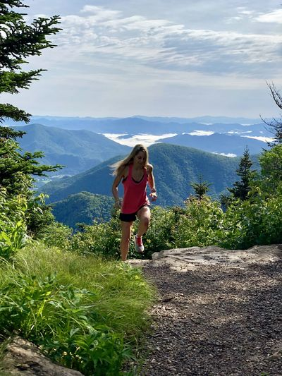 Full length of woman on mountains against sky
