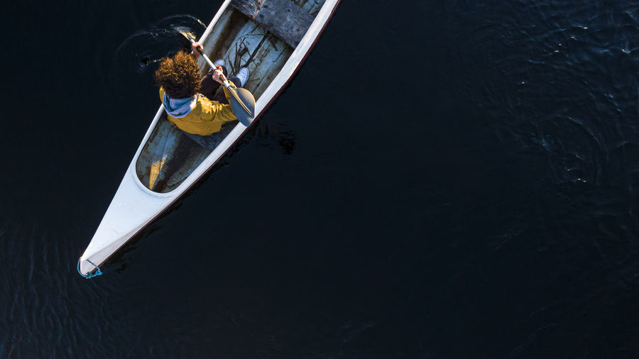 High angle view of person on boat in canal