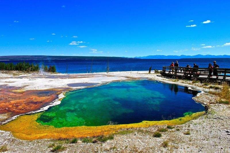 Tourists At Abyss Pool In West Thumb Geyser Basin
