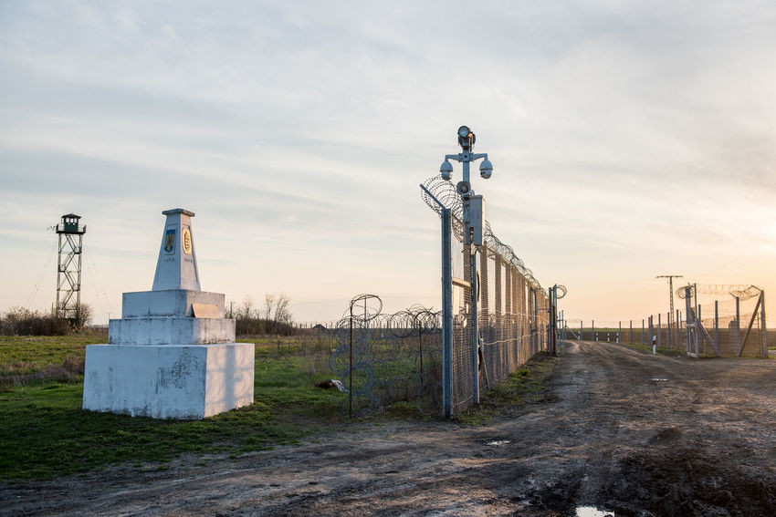 Barbed Wire Hungarian Border Hungary Architecture Barrier Border Border Barrier Boundary Building Exterior Built Structure Cloud - Sky Day Direction Factory Fence Field Hungarian Border Fence Industry Land Metal Nature No People Outdoors Security Sky Sunset