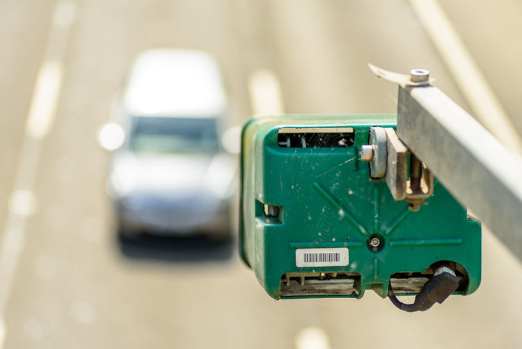 Day view of average speed traffic camera over UK Motorway. Average Camera - Photographic Equipment Close-up Day Daylight Focus On Foreground Green Color Motorway No People Outdoors Retro Styled Speed Uk
