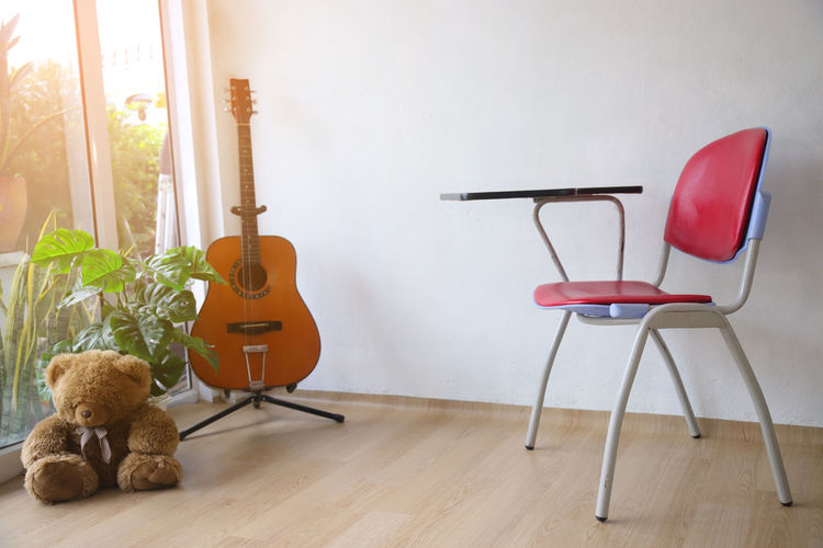 Empty chairs and tables on hardwood floor at home
