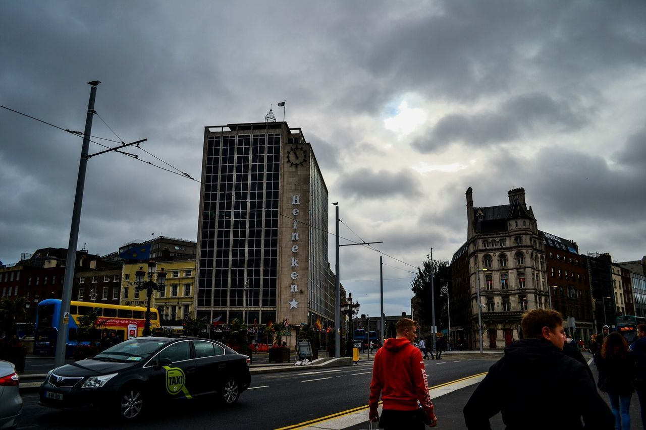 architecture, built structure, city, sky, cloud - sky, building exterior, street, real people, road, outdoors, modern, day