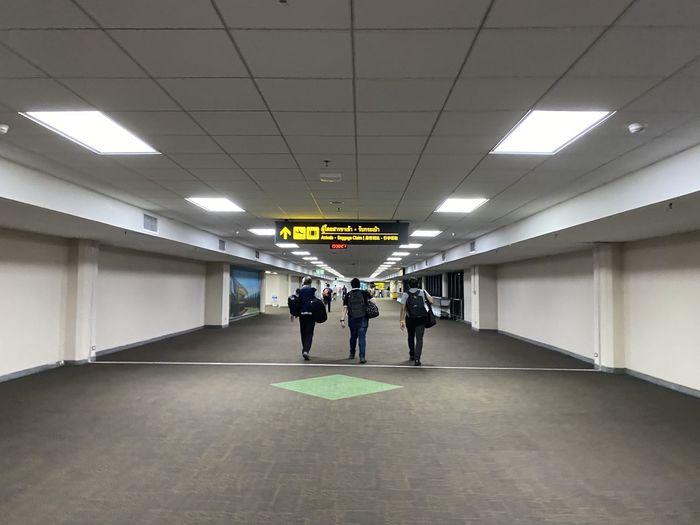 People walking in subway tunnel
