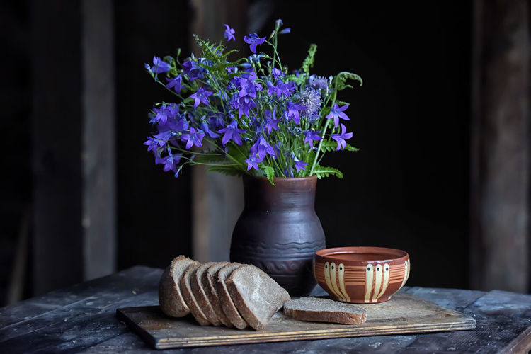 Close-up of purple flower in pot on table