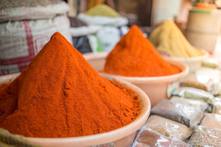 Spices in a local market in New Delhi Asian  Chilly Pepper Eating Indian Spices Asian Food Chilli Close-up Container Flavour Food Food And Drink For Sale Freshness Heap In A Row Indian Food Ingredient Market Market Stall Pepper - Vegetable Spice Strong Turmeric  World Flavours