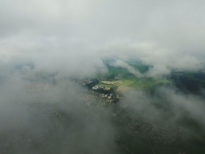 Aerial view of town seen through clouds