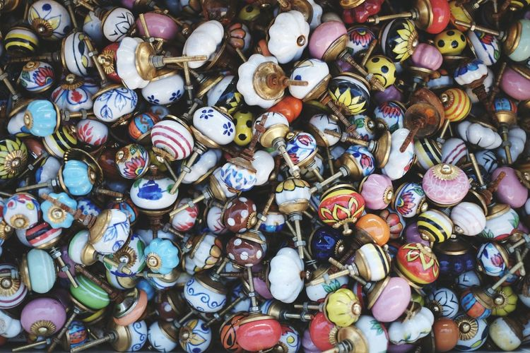 Full frame shot of multi colored doorknob for sale at market stall