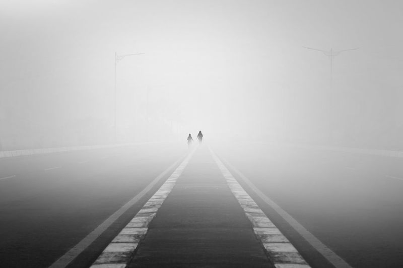The Morning Mist Walking Road Blackandwhite Black And White Black & White Angle Minimalist Lessismore Minimalism 17.62° City Full Length Fog Winter Cold Temperature Rear View Foggy Empty Road Weather Mist