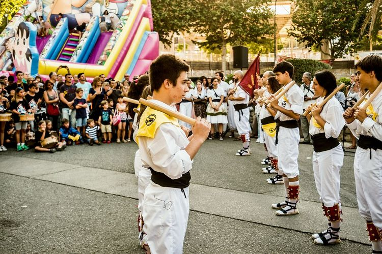 Ball de bastons (Catalan pronunciation: [ˈbaʎ də βəsˈtons], stick dance) is the name of a ritual weapon dance spread throughout Europe and the rest of the Iberian area (cossiers in Majorca, Portuguese pauliteiros, Aragonese palotiau, Basque ezpatadantza and Spanish paloteo ortroqueado) but mostly in Catalonia. English and Welsh Morris dances are well-known relatives to these traditions. The origins of dance are difficult to reference; first recorded mention dates to 1150, in a banquet of Count Berenguer IV) Most melodies are based on easy 2/4 rhythms. Instrumentarium includes tabor pipe, shawm or bagpipes. Some of these tunes as Villano de Zamora were strikingly popular grounds among European Renaissance and Baroque composers. Various different traditions are encompassed in the phrase, but normally the dancers will all carry one or two sticks (bastons) traditionally of holm oak, about 40–50 cm long and 5 cm thick. In the most common set, two opposite rows of dancers elaborate some patterns of stick-clashing. Sometimes, a peculiar chief character directs the movements and changes. The dancers may wear white skirts or short trousers, as well as red ribbons and ornaments. Ball De Bastons Stick Dance Open Edit Traditions Popular Culture Color Traditional Clothing
