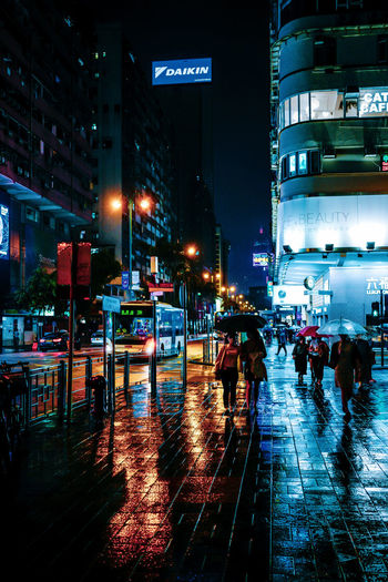 Wet city street during rainy season at night