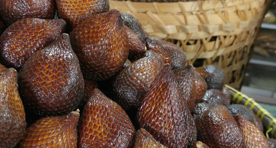 Close-Up Of Snake Fruits In Basket