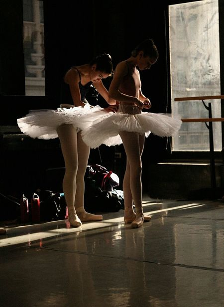 Ballerinas helping each other to get ready for Ballet Rehearsal in New York City for the The Nutcracker Ballet #Ballet #Nutcracker #ballerinas #dancing
