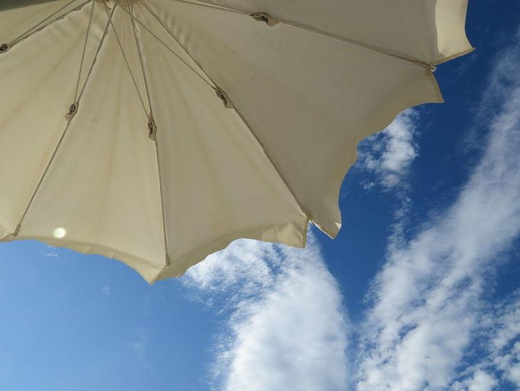 Blue Blue Sky Cloud - Sky Good Weather Holiday Holidays Low Angle View Parasol Protection Sardinia Sardinia Sardegna Italy  Shade Shelter Sky Summer Summertime Sun Umbrella Sunbath Sunbathe Sunbathing Sunshade Umbrella Vacation Vacation Time Vacations