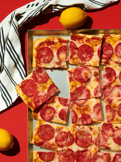 Close-up of pizza slices in tray on table