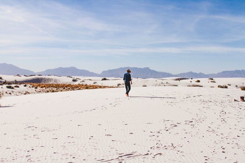The Drifter (White Sands National Monument) || Full Length One Person Walking Real People Day Sand Nature Outdoors Leisure Activity Sky Beauty In Nature Lifestyles Mountain Scenics Beach Women Adult People Fresh On Market 2017