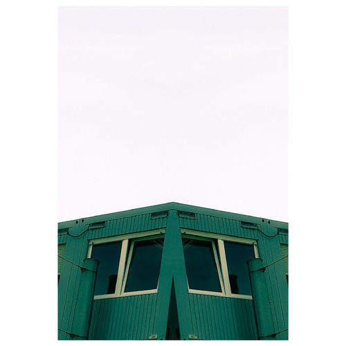 The green Container Glass Windows Zoom Centered Perspective Centered Shapes , Lines , Forms & Composition Container Double Eyes Face In Front Copy Space City Marketing Marketing Left Right Pair Mirrored White Background Close-up Architecture Building Exterior Built Structure Green Color Geometric Shape Rectangle Shape Symmetry Geometry Abstract Backgrounds