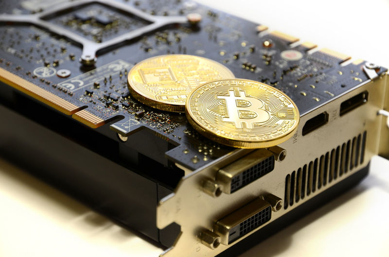 Close-up of bitcoins on computer equipment over white background