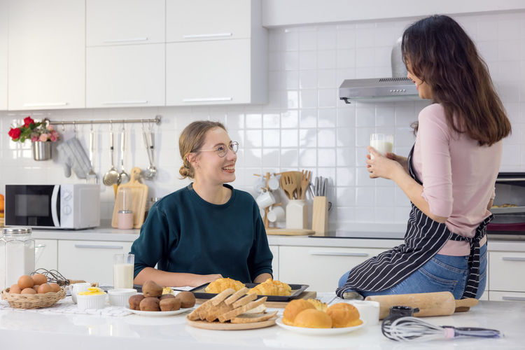 Women standing on table at home