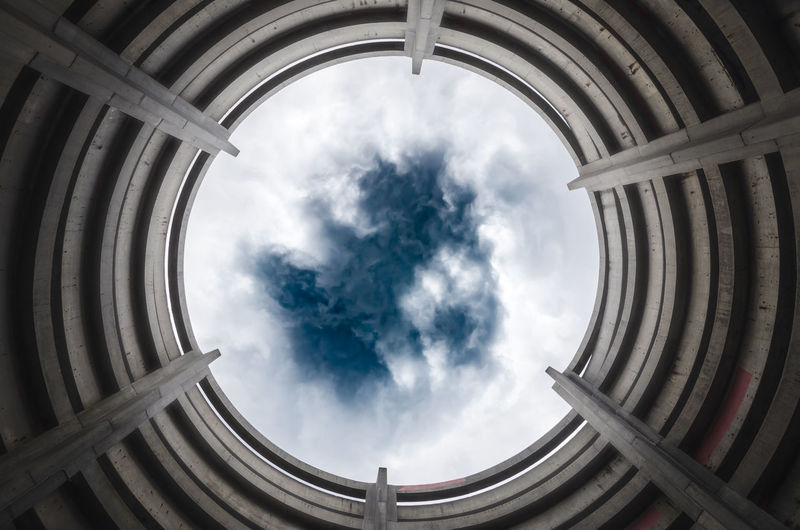 Looking up at a stormy sky through unique architecture Architecture Connecticut New Haven New Haven, CT Abstract Architecture Building Exterior Built Structure Cloud - Sky Day History Low Angle View No People Outdoors Sky Travel Destinations
