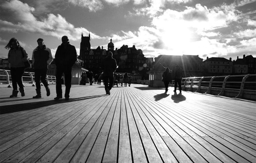 Cromer Pier Shadows Two Cromer Pier Cromer Real People Sunlight Cloud - Sky Outdoors People Lifestyles Shadows Shadows And Silhouettes Shadows And Sunlight Walking Walkers EyeEmNewHere Blackandwhite Photography