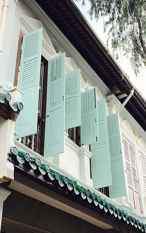 Shophouse shutters. Singapore Architecture Building Exterior Low Angle View Built Structure Window Clear Sky City Sky High Section Day Modern No People Cloud - Sky City Life Exterior Shophouse Singapore Shutters Mintgreen Fresh Natural Ventilation