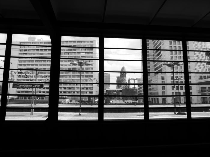Berlin Train Station Black & White Kaiser Wilhelm Memorial Church Old West Berlin Centre Architecture Building Exterior Built Structure City Cityscape Day Indoors  Inside View Out Modern Monochrome Photography No People Skyscraper Through The Window Window