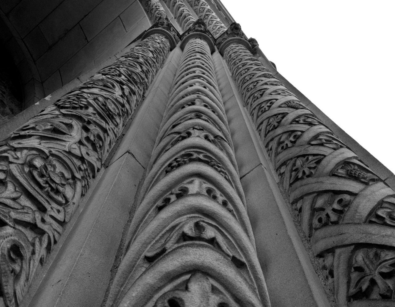 no people, low angle view, architecture, pattern, built structure, indoors, close-up, history, day, the past, design, sky, in a row, building, clear sky, creativity, metal, wall - building feature, wheel, floral pattern, directly below