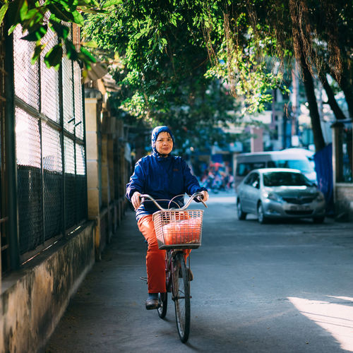 Portrait of woman cycling on street