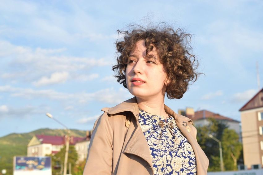 Curly Hair Young Adult Young Women Day Outdoors Sky One Person Built Structure Portrait Real People Nature Smiling Beautiful Woman Architecture People Adult