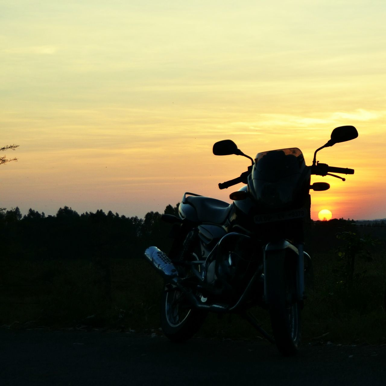 sunset, transportation, orange color, stationary, mode of transport, land vehicle, silhouette, outdoors, sky, no people, motorcycle, nature, beauty in nature, day