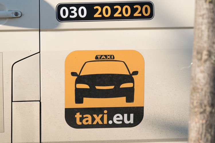 Berlin, Germany - March 19, 2018: Taxi.eu advertising banner. Taxi app to book cabs Advertising App Business Service Taxi Transport Transportation Advertisement Banner Banner - Sign Booking Close-up Communication Day Marketing No People Outdoors Taxi.eu Taxis Text Yellow