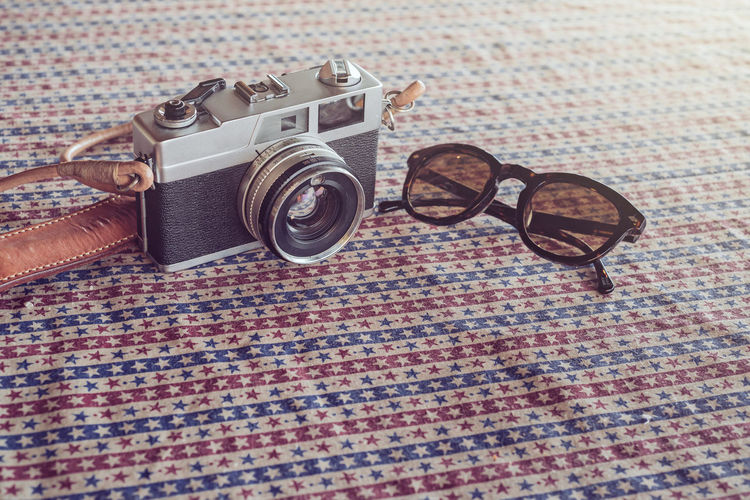Vintage 35mm Film Camera and Vintage Sunglasses Photography Themes Camera - Photographic Equipment Glasses Technology Photographic Equipment Eyeglasses  Retro Styled No People Indoors  Still Life Fashion Camera Sunglasses Photographing Table Lens - Optical Instrument Single Object Close-up Activity Digital Camera Personal Accessory SLR Camera Film Film Photography Film Industry Filmcamera Vintage Vintage Style Lifestyles Life Is A Beach Vintage Sunglasses Travel Travel Destinations Travel Photography Travelling