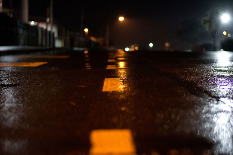 Surface level of wet road at night