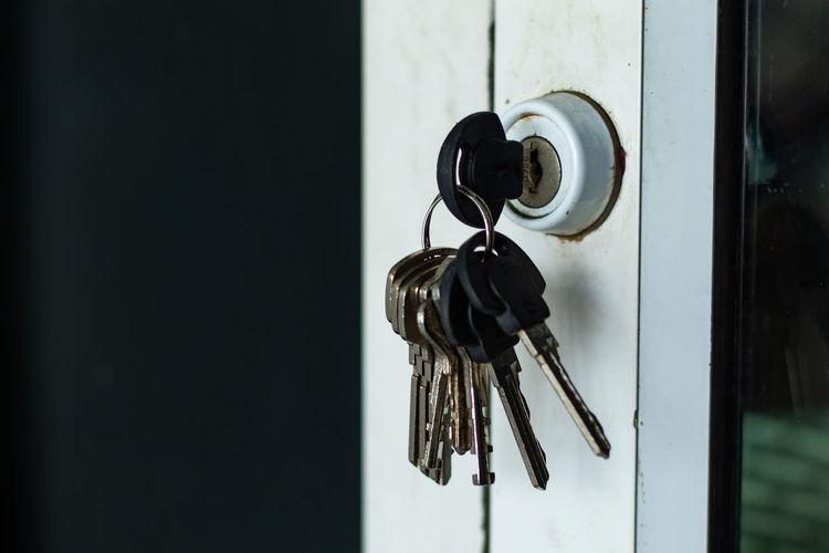 Close-up of keys in door lock