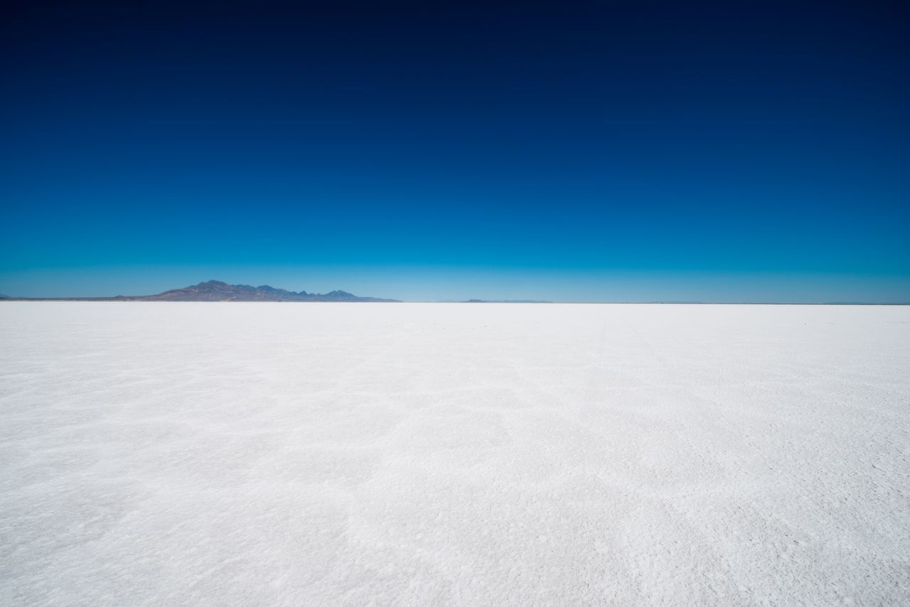 blue, scenics - nature, clear sky, copy space, tranquil scene, tranquility, beauty in nature, landscape, sky, environment, desert, no people, mineral, nature, day, salt flat, land, idyllic, non-urban scene, sand, arid climate, climate, outdoors