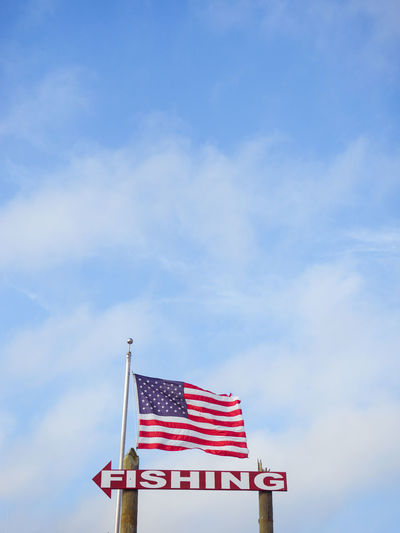 Fish that way Flag Sky Low Angle View Cloud - Sky Patriotism Striped Blue No People Nature Day Outdoors Red National Icon Fishing Sign America