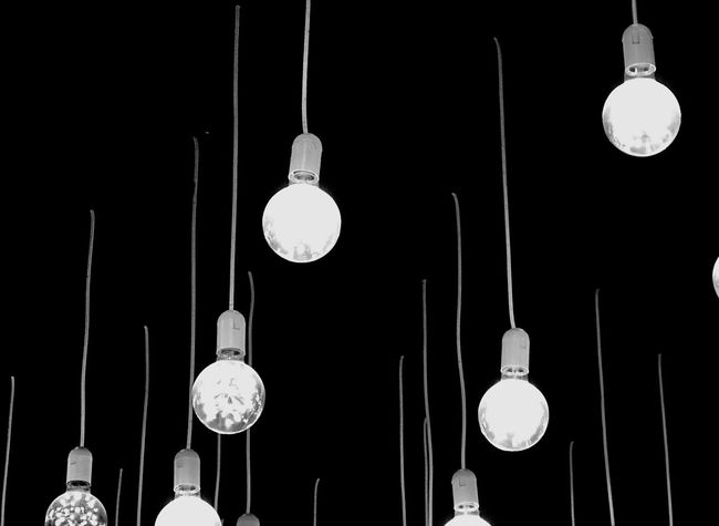 Abstract Blackandwhite Building Exterior Light Room Design Decoration Hanging Lighting Equipment Low Angle View Illuminated Light Bulb Electricity  Decoration Light Electric Lamp Architecture Glowing Indoors  No People Electric Light Group Of Objects Built Structure Pendant Light Metal Cable Night