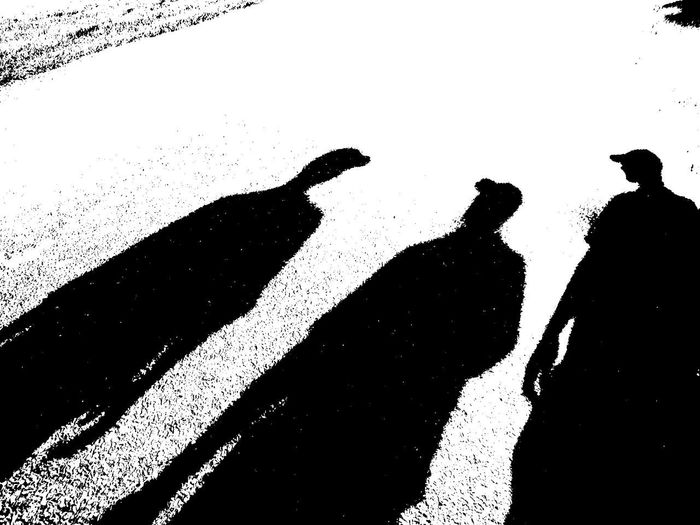 Silhouette people shadow against blurred background