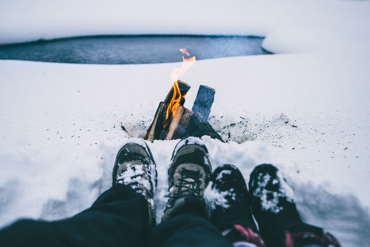 Adventure Adventure Club Campfire Camping Couple Couples Fire Flame Fun Holiday Human Body Part Human Leg Leisure Activity Life Lifestyles Low Section Men Outdoor Photography Outdoors Person Still Life Travel Water Winter Woman Connected By Travel