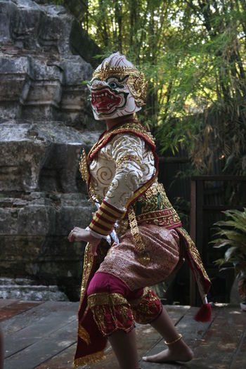 Side View Of Woman Wearing Costume Dancing Outdoors