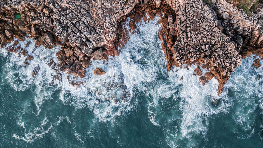 Drone top view of sea waves hitting rocks on the rock cliff seascape in the Portuguese coastline, Cascais. Geology DJI Mavic Pro DJI X Eyeem Top View Top Perspective Aerial View Aerial Photography High Angle View Waves Shore Cliff Beauty In Nature Nature Directly Above Drone  Tourist Attraction  Tourist Destination Travel Destinations Rock - Object Seascape Sea Turquoise Water Rock Formation Coastline Outdoors