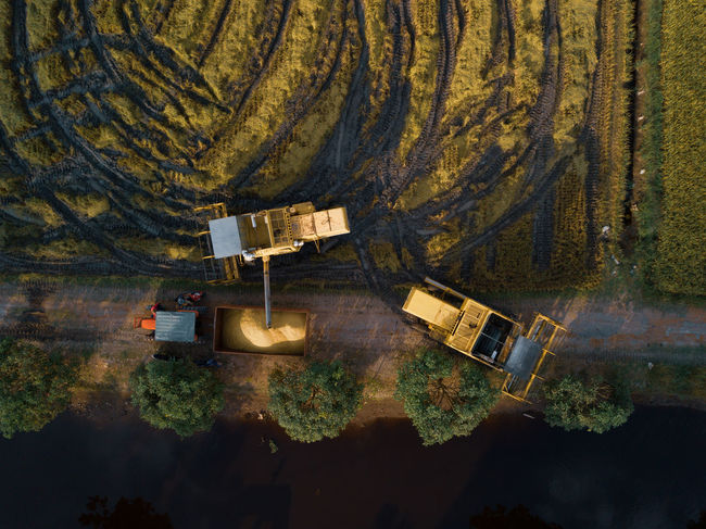 High Angle View No People Transportation Day Nature Directly Above Water Outdoors Dirt Tree Business Mode Of Transportation Industry Technology Reflection Wood - Material Non-urban Scene Speed Architecture Harvester Harvesters