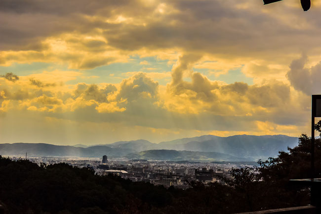 Sunbeams shining through the clouds over the city of Kyoto, Japan. View of Kyoto city from Kiyomizu temple with dramatic cloudy sky and sun beams on background. Cityscape Kiyomizu-dera Kiyomizu-dera Temple KiyomizuTemple Kyoto Temple Kyoto, Japan Sunbeams Through The Clouds Architecture Beauty In Nature Cityscape Cloud - Sky Kiyomizu Kyoto Kyoto City Mountain Nature Outdoors Scenics Silhouette Sky Sun Beam Sunbeam Sunbeams Through Clouds Sunset Tree