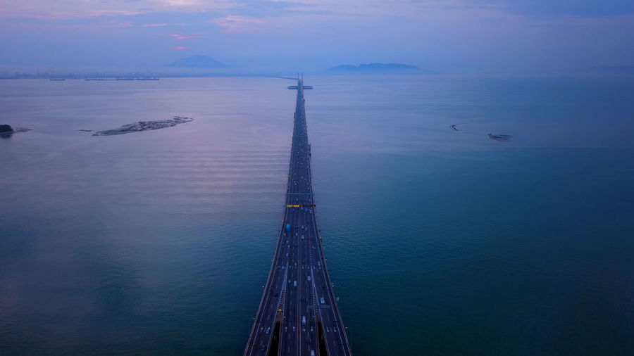High angle view of bridge over sea against sky during sunset