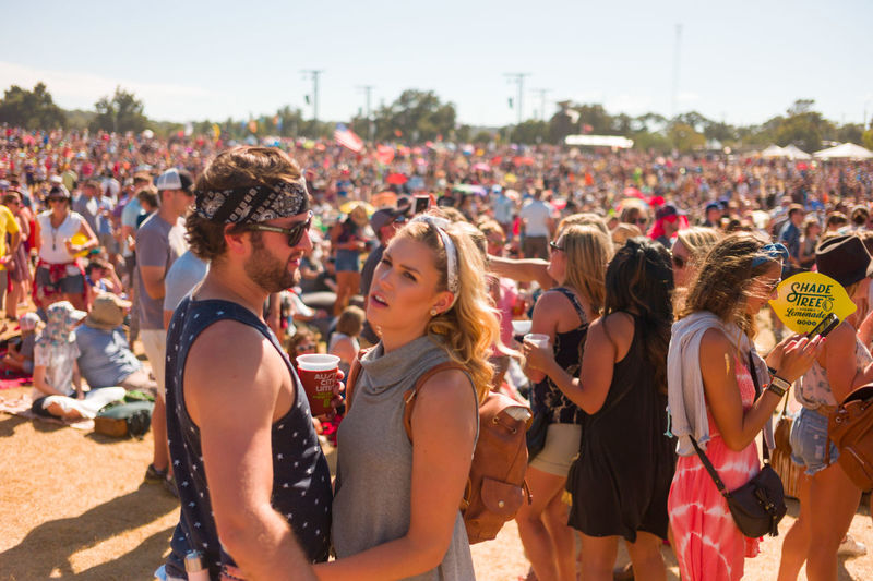Austin City Limits Casual Clothing City Life Clear Sky Couple Crowd Day Enjoyment Event Focus On Foreground Large Group Of People Leisure Activity Lifestyles Outdoors Person Sitting Sky Togetherness Tourism Vacations Weekend Activities Streetphotography