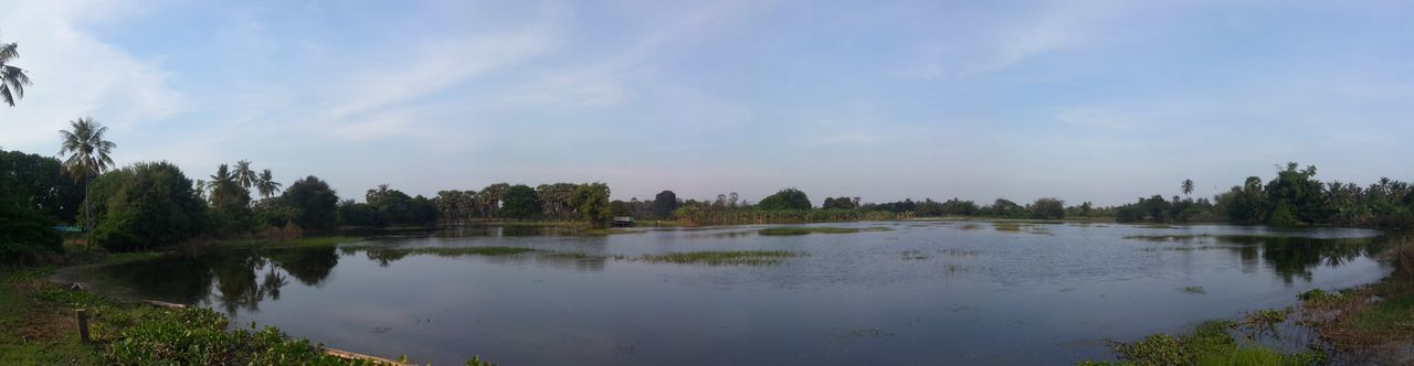 Beauty In Nature Calm Cambodia Cloud - Sky Countryside Day Green Green Color Growth Lake Majestic Nature No People Non-urban Scene Outdoors Remote Scenics Sky Solitude Tranquil Scene Tranquility Tree Water Waterfront WoodLand