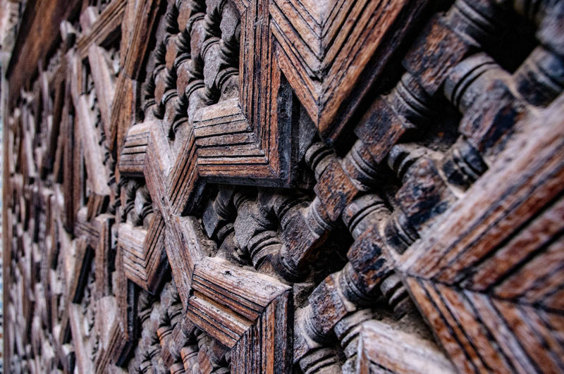 Full Frame Wood - Material Backgrounds Pattern Craft Selective Focus No People Day Carving - Craft Product Textured  Close-up Creativity History The Past Art And Craft Outdoors Architecture Design Place Of Worship Door Ornate Carving